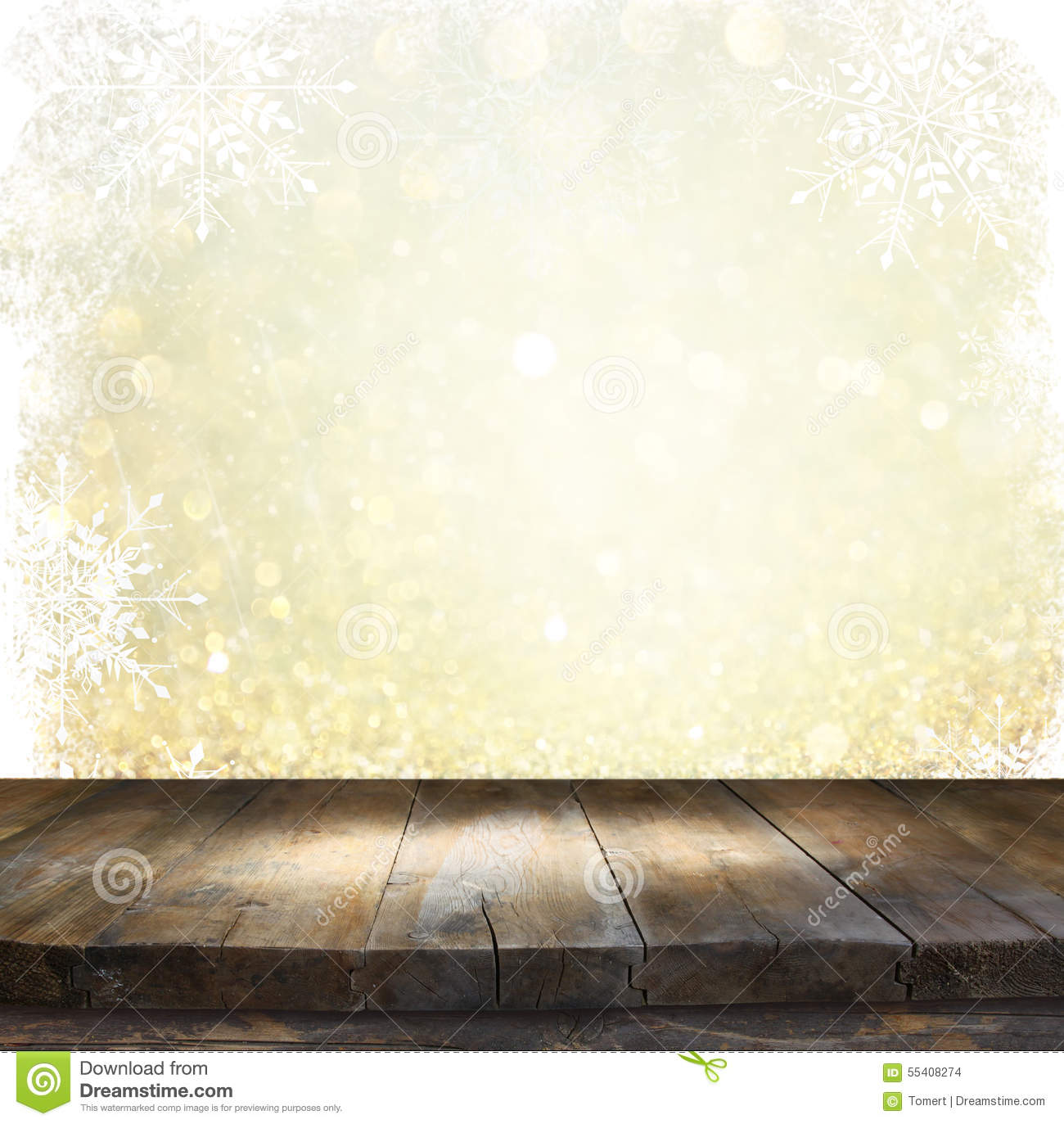 rustic wood table in front of glitter silver and gold bright bokeh lights with snowflacke overlay