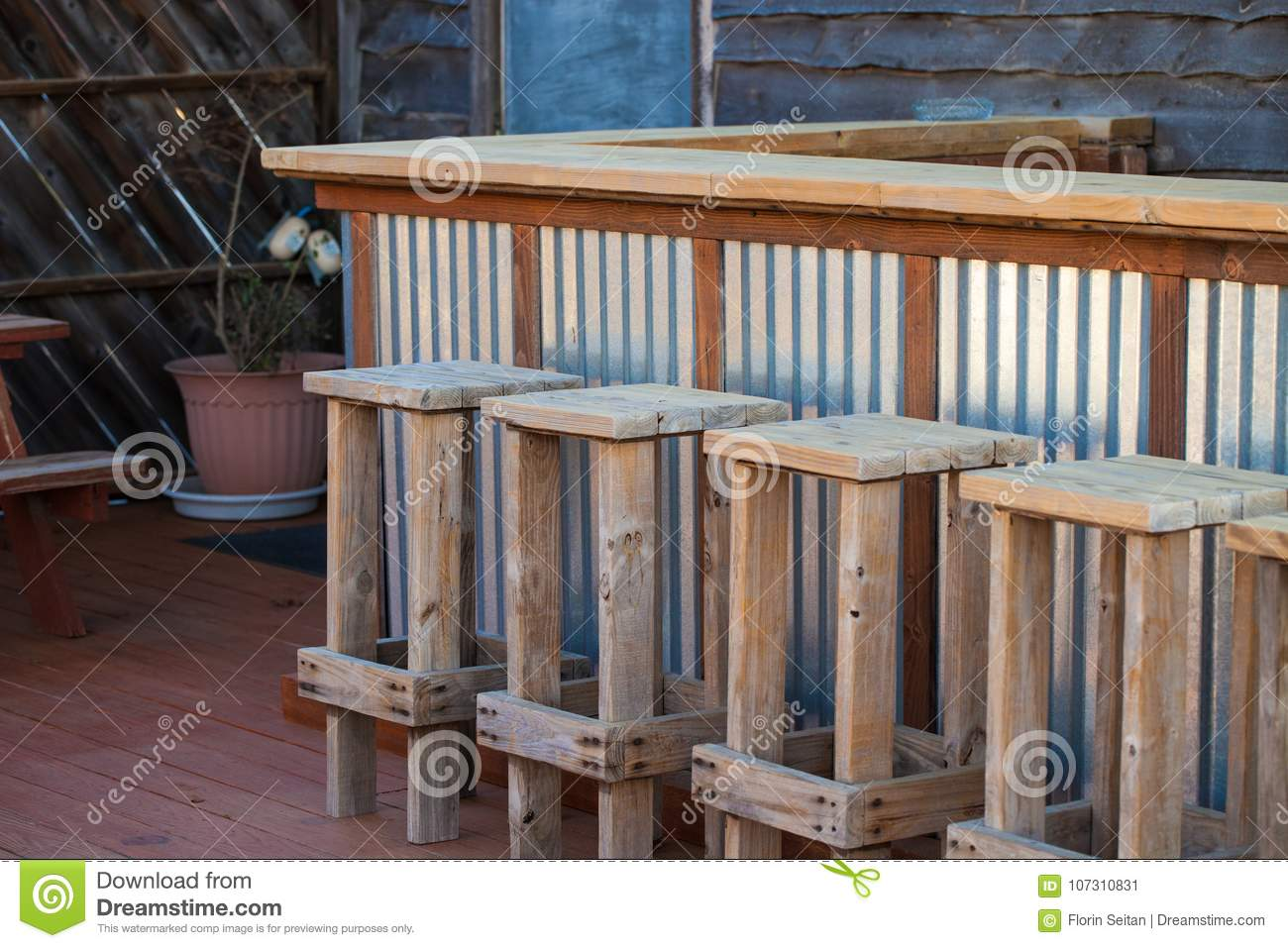 Pleasant Rustic Wooden Bar And Stools On Empty Patio Stock Image Lamtechconsult Wood Chair Design Ideas Lamtechconsultcom