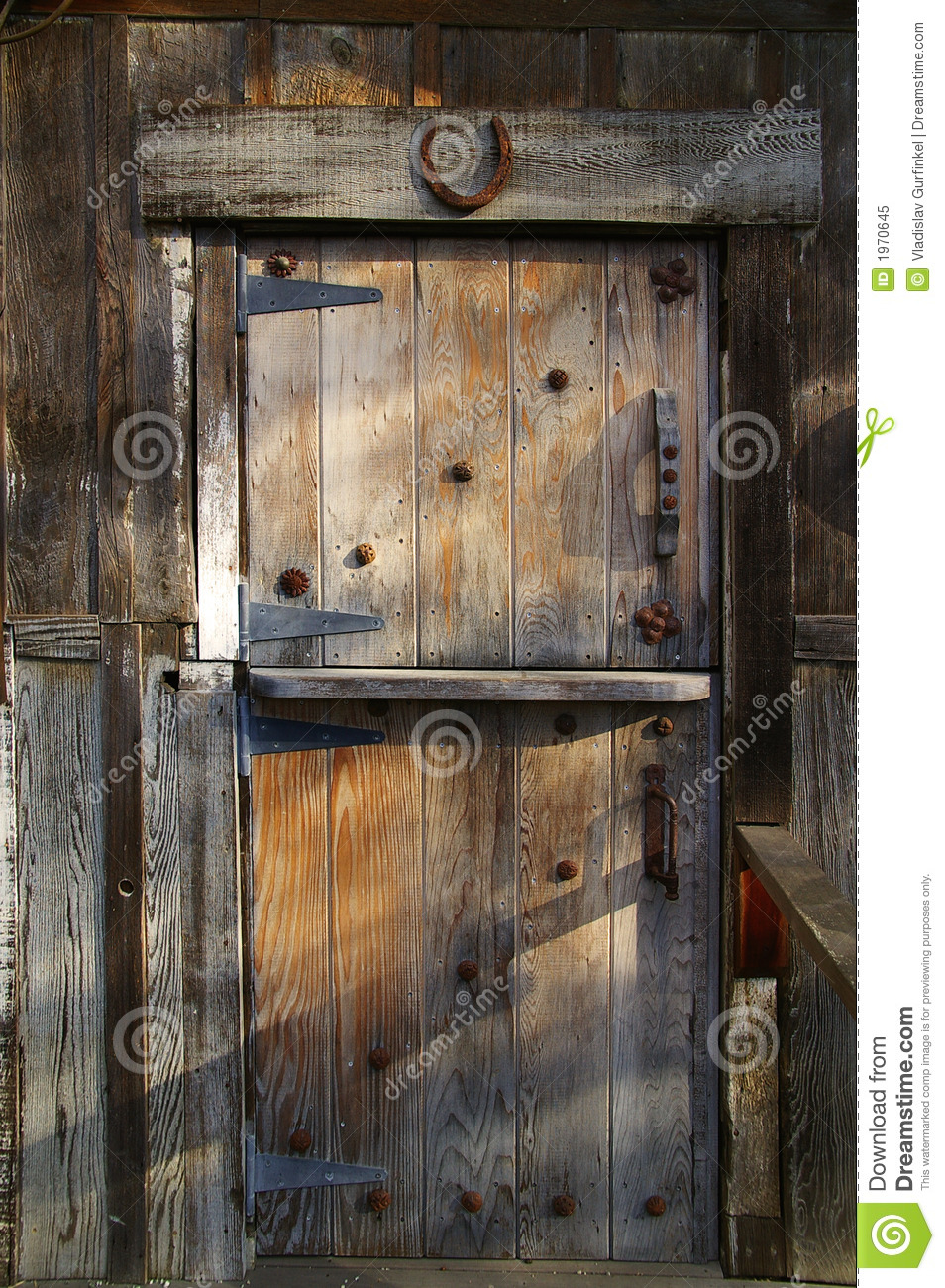 Rustic wooden barn door stock image of home metal