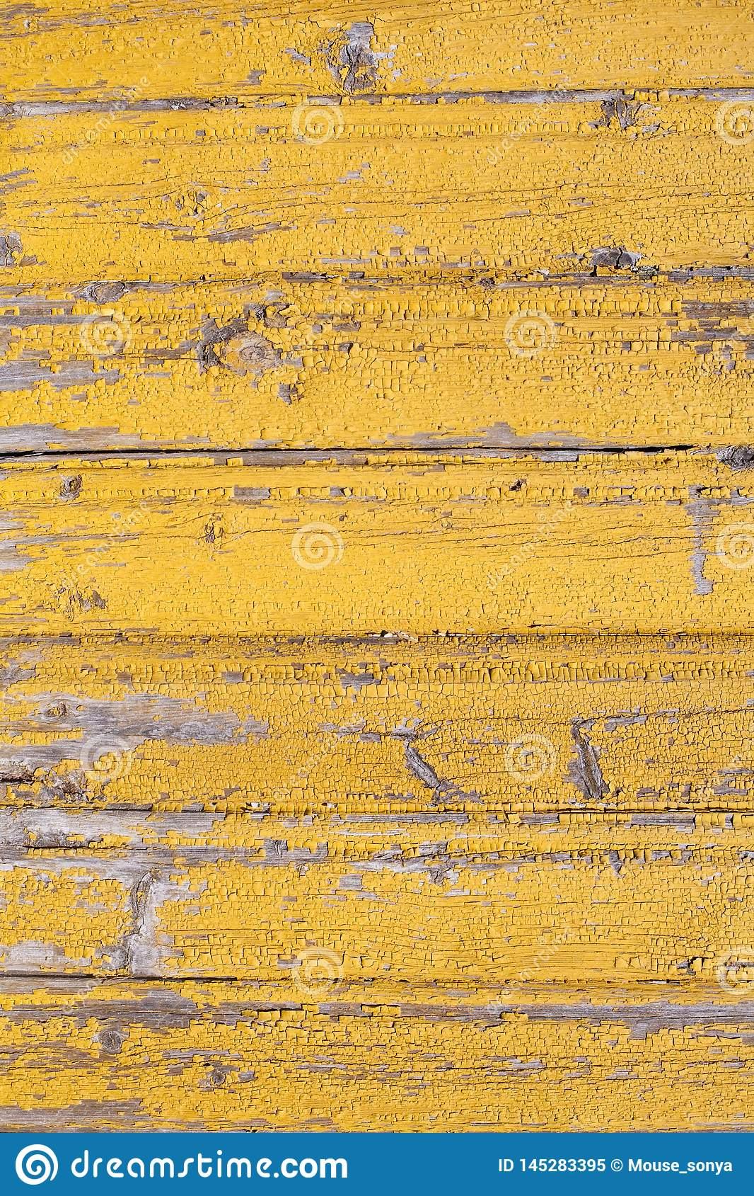 Rustic wooden old flaked  yellow painted texture of planked wall pattern