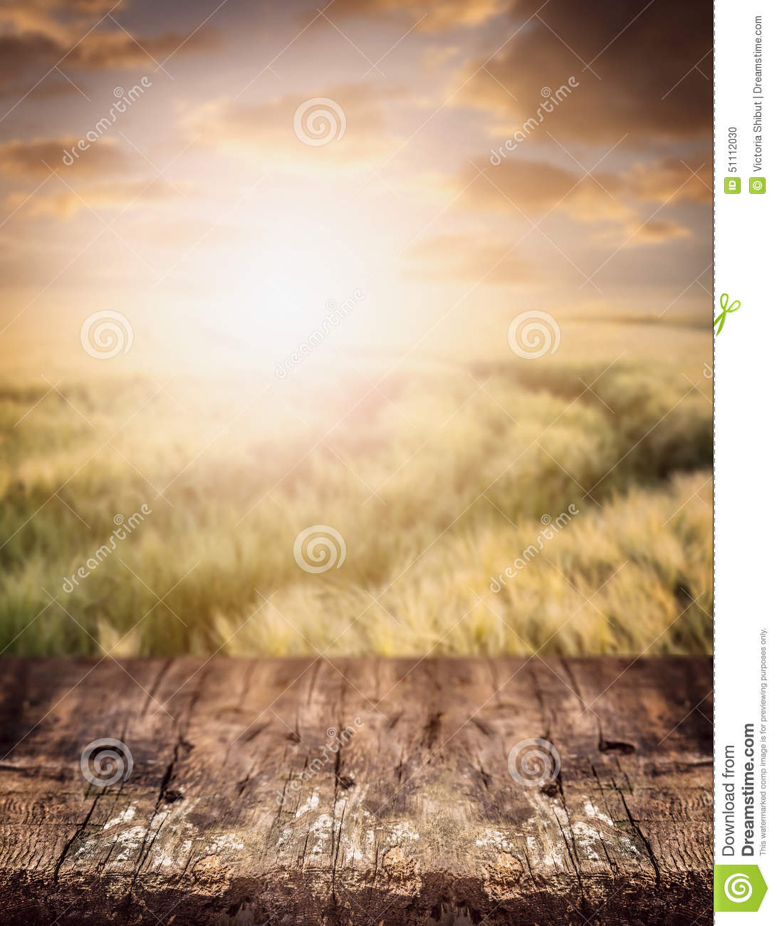 Rustic Wooden Table Over Wheat Field And Sunset Sky