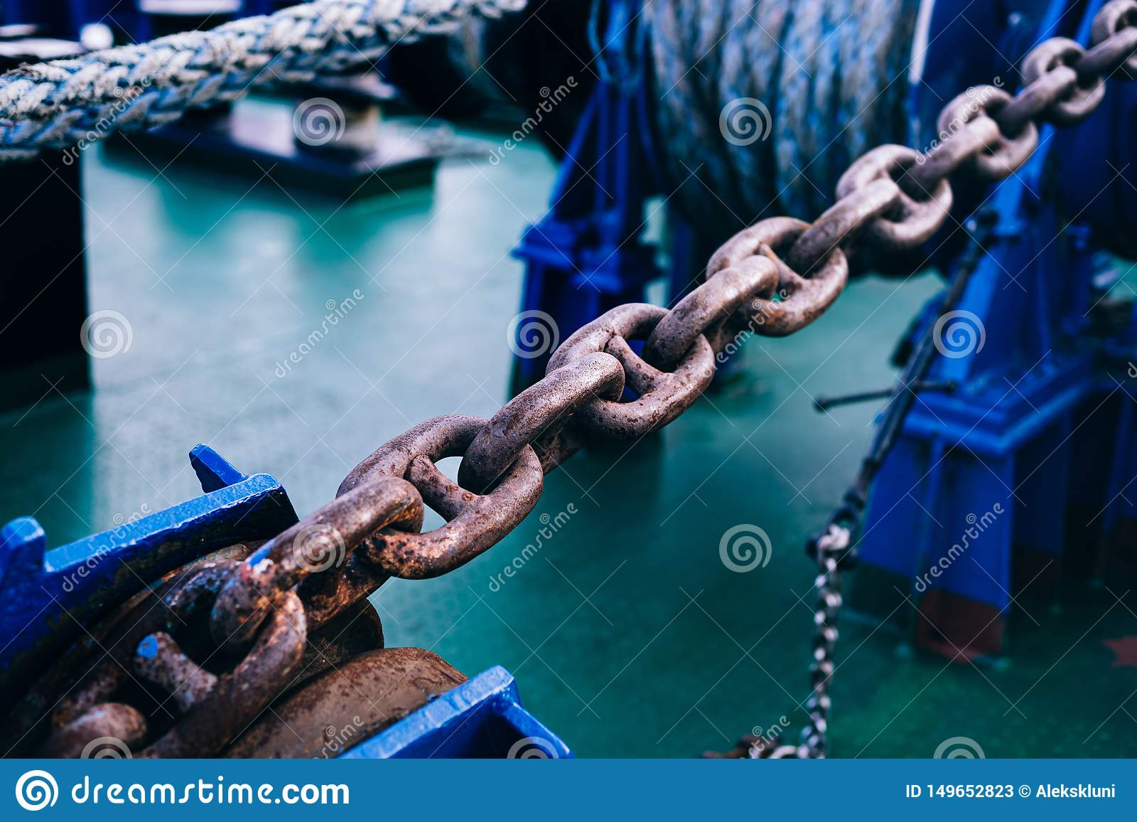 Rusty anchor chain on the bow. Part of mooring equipment. Blur. Close-up. Background