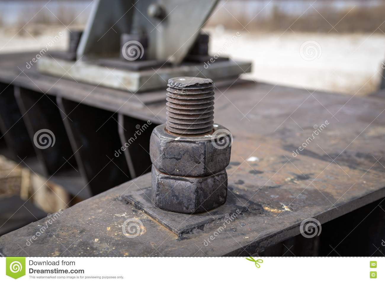 The rusty bolt is an element of the metal structure.