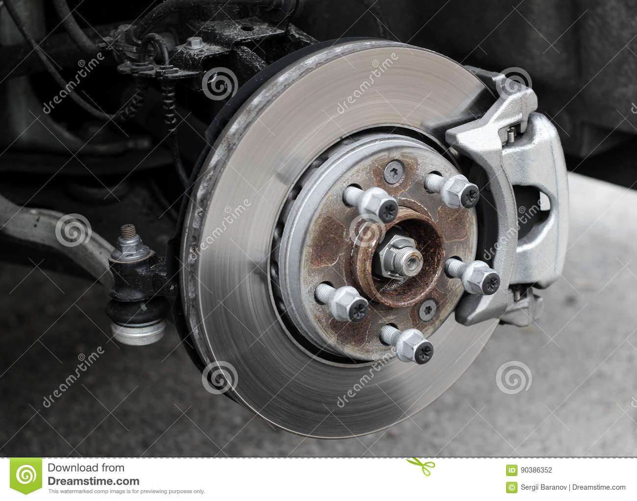 Using Car Brakes : Car brake disc with pads royalty free stock image