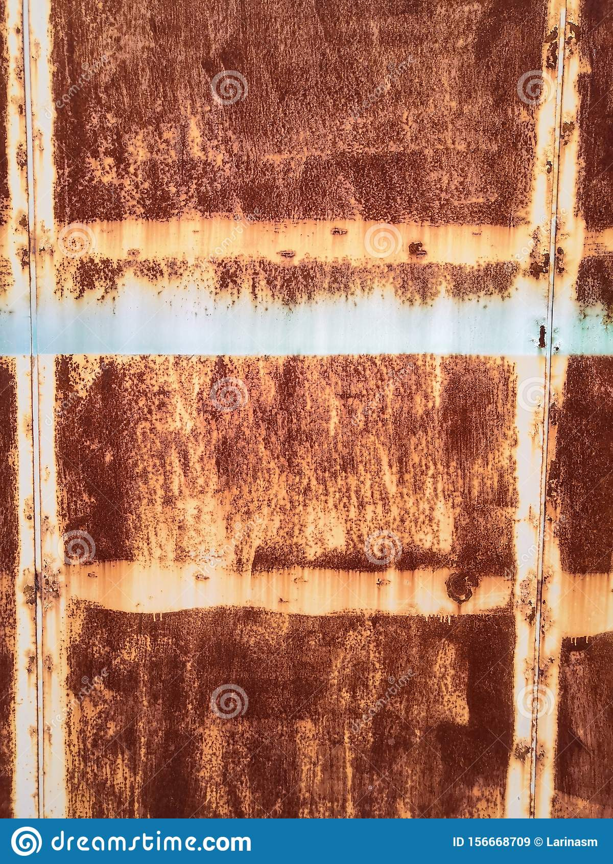 Rusty brown metal wall with yellow patterns. metal rust texture background