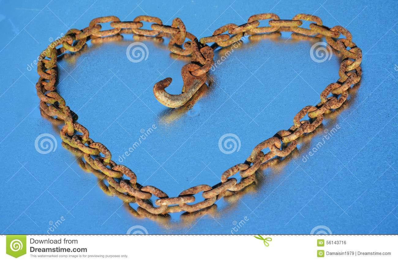 Rusty chain heart and dew