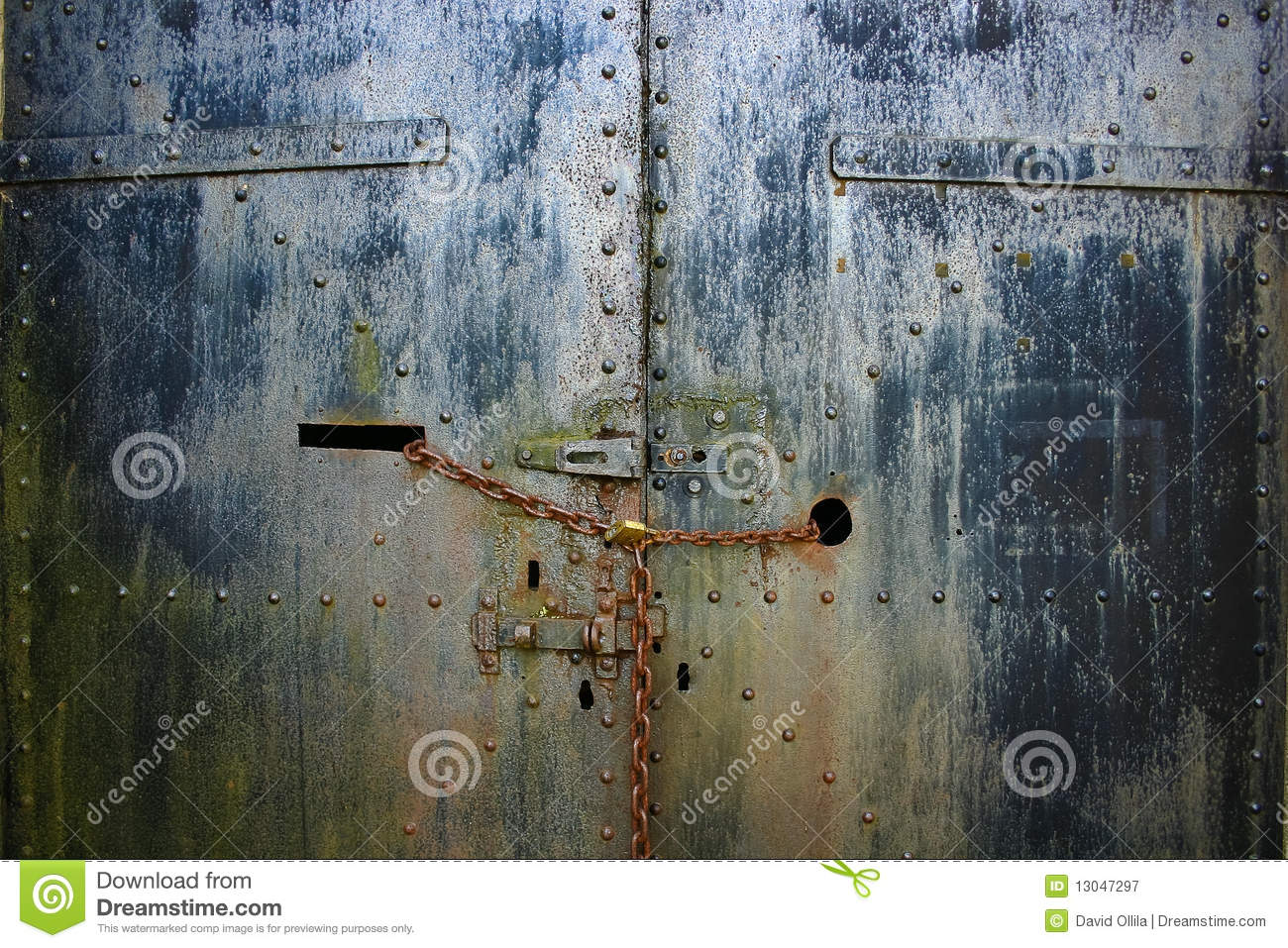 Rusty Chain Lock And Steel Armory Doors Royalty Free