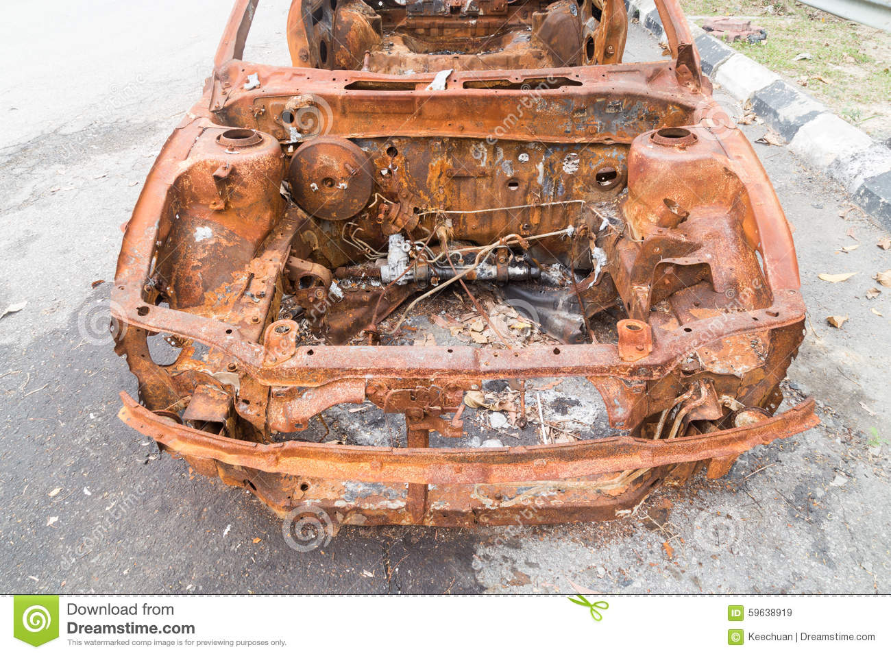 rusty chassis of a burnt car abandoned by the side of the. Black Bedroom Furniture Sets. Home Design Ideas