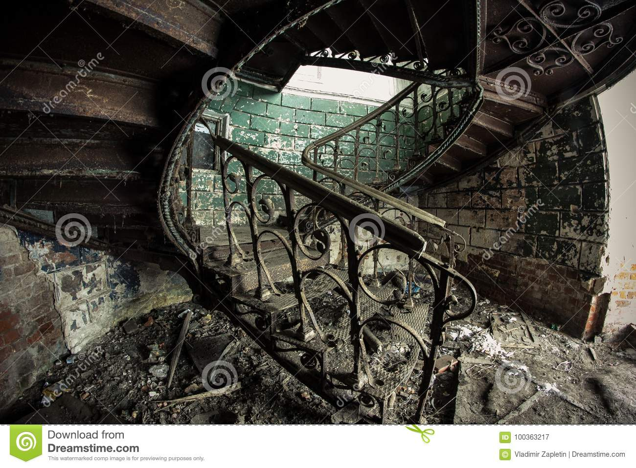 Rusty Decorated Vintage Spiral Staircase In Abandoned Mansion Stock
