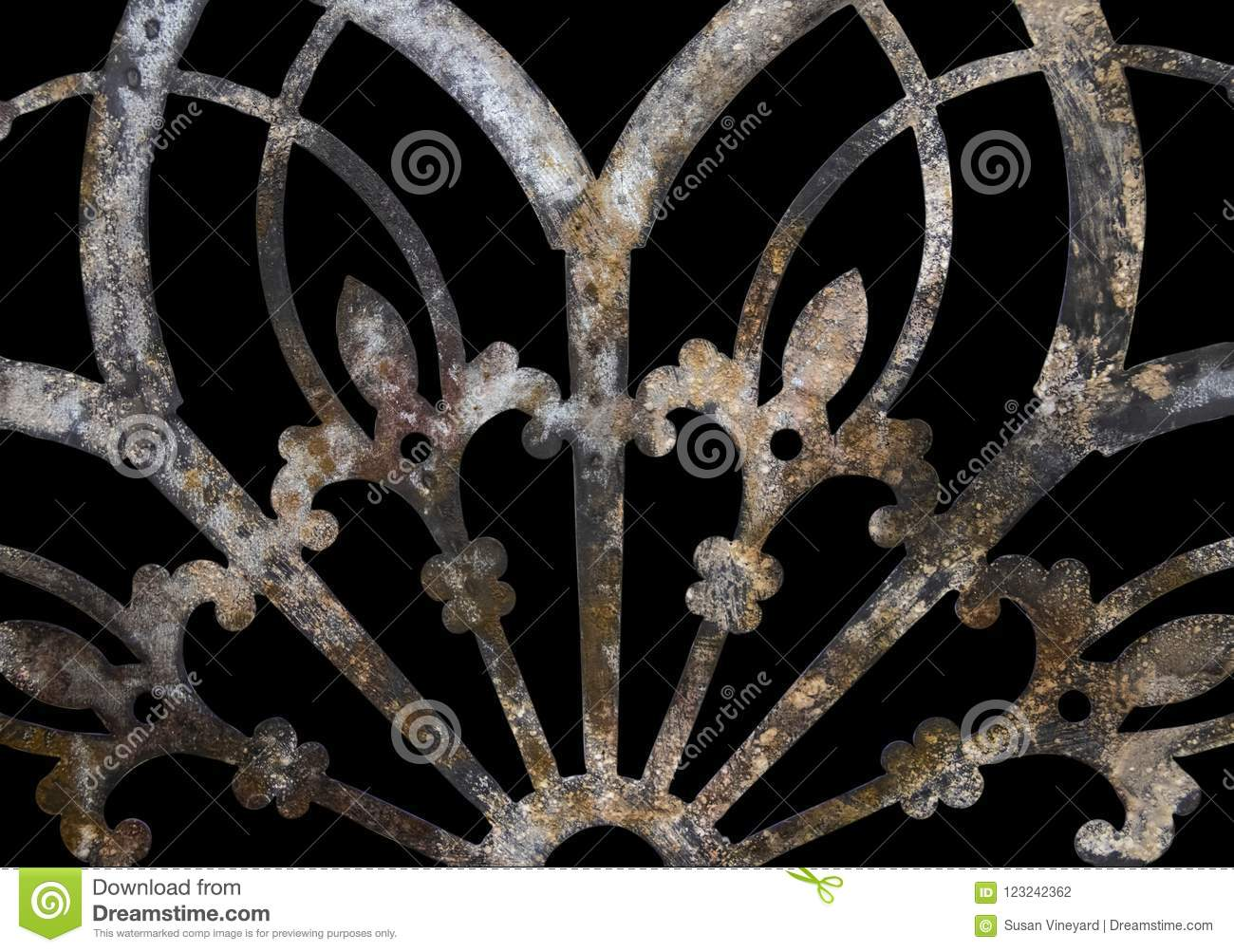 Rusty iron grunge lacy metal decoration with fleur-de-lis isolated on black