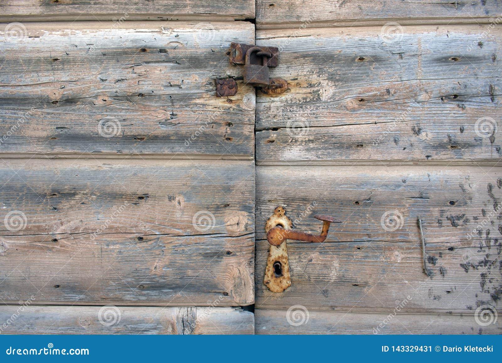 Rusty lock on old wooden doorsc