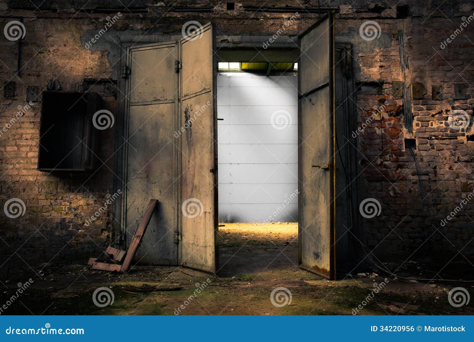 Rusty Metal Door rusty metal door in an abandoned warehouse royalty free stock