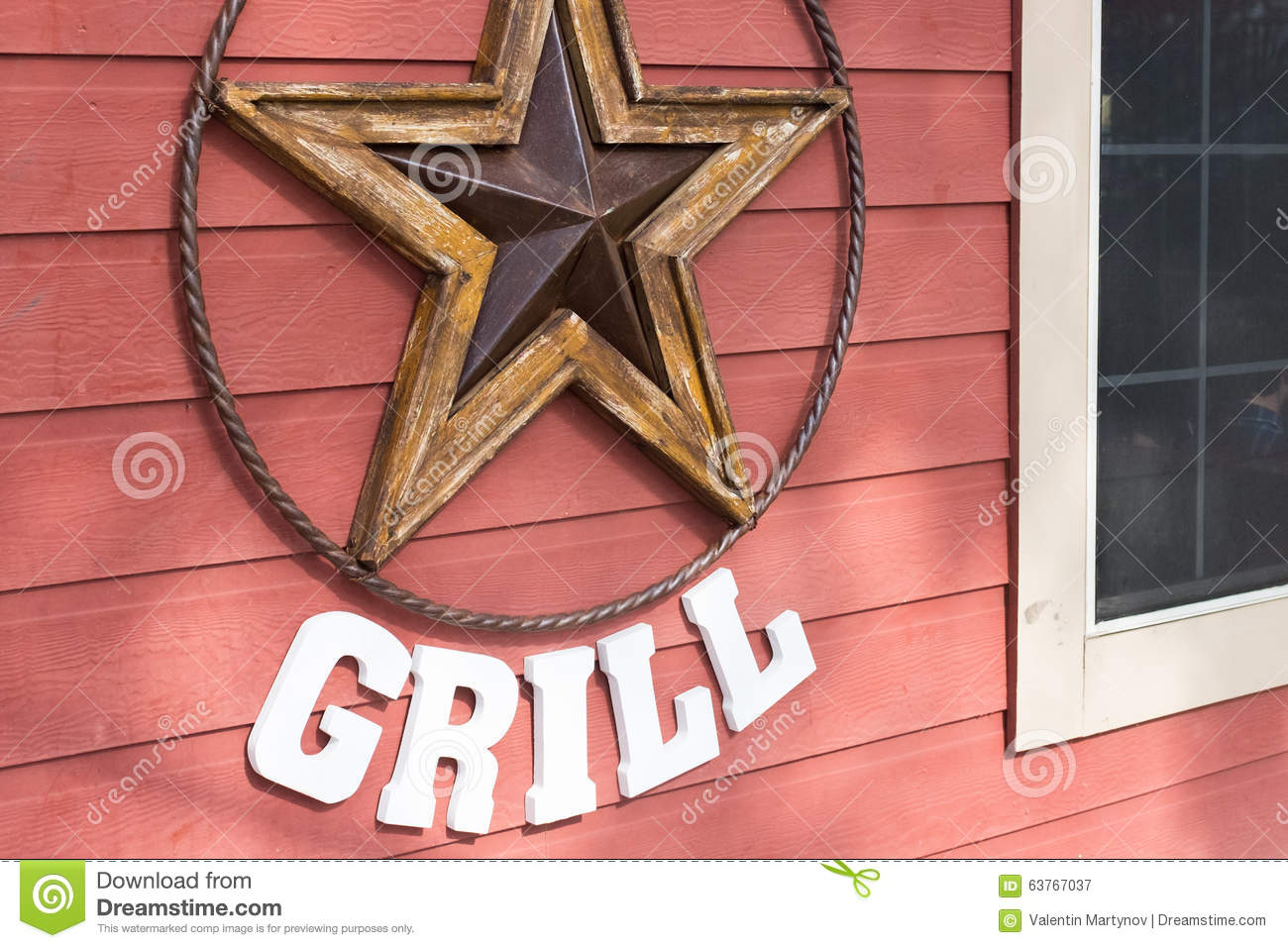Rusty Metal Star Sign Hanging On A Wooden Wall Of A Grill