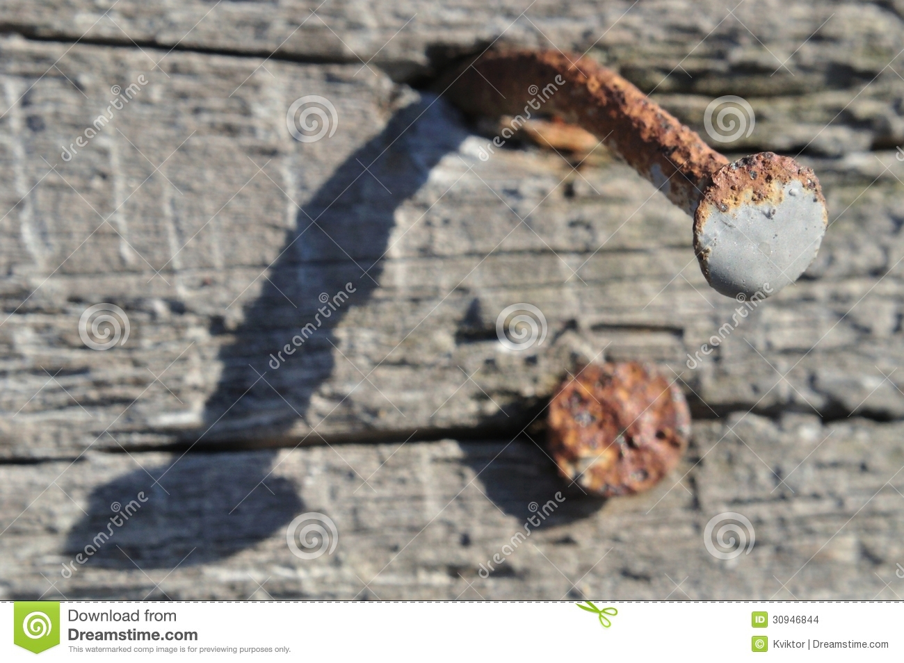 Rusty Nail On Old Wood Stock Images - Image: 30946844
