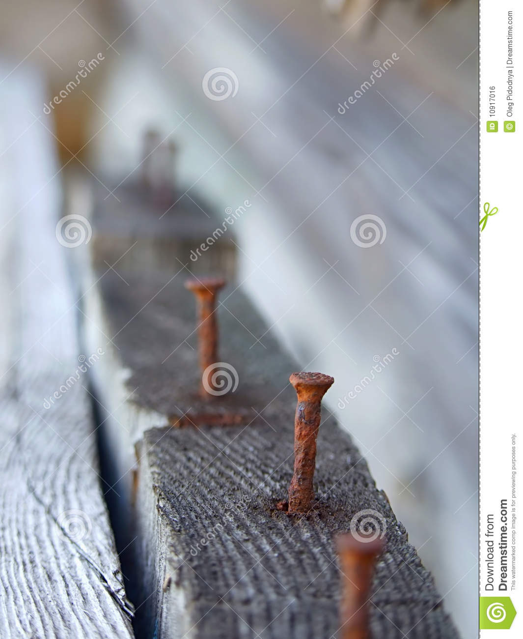 Rusty Nail In Wood Royalty Free Stock Image - Image: 10917016
