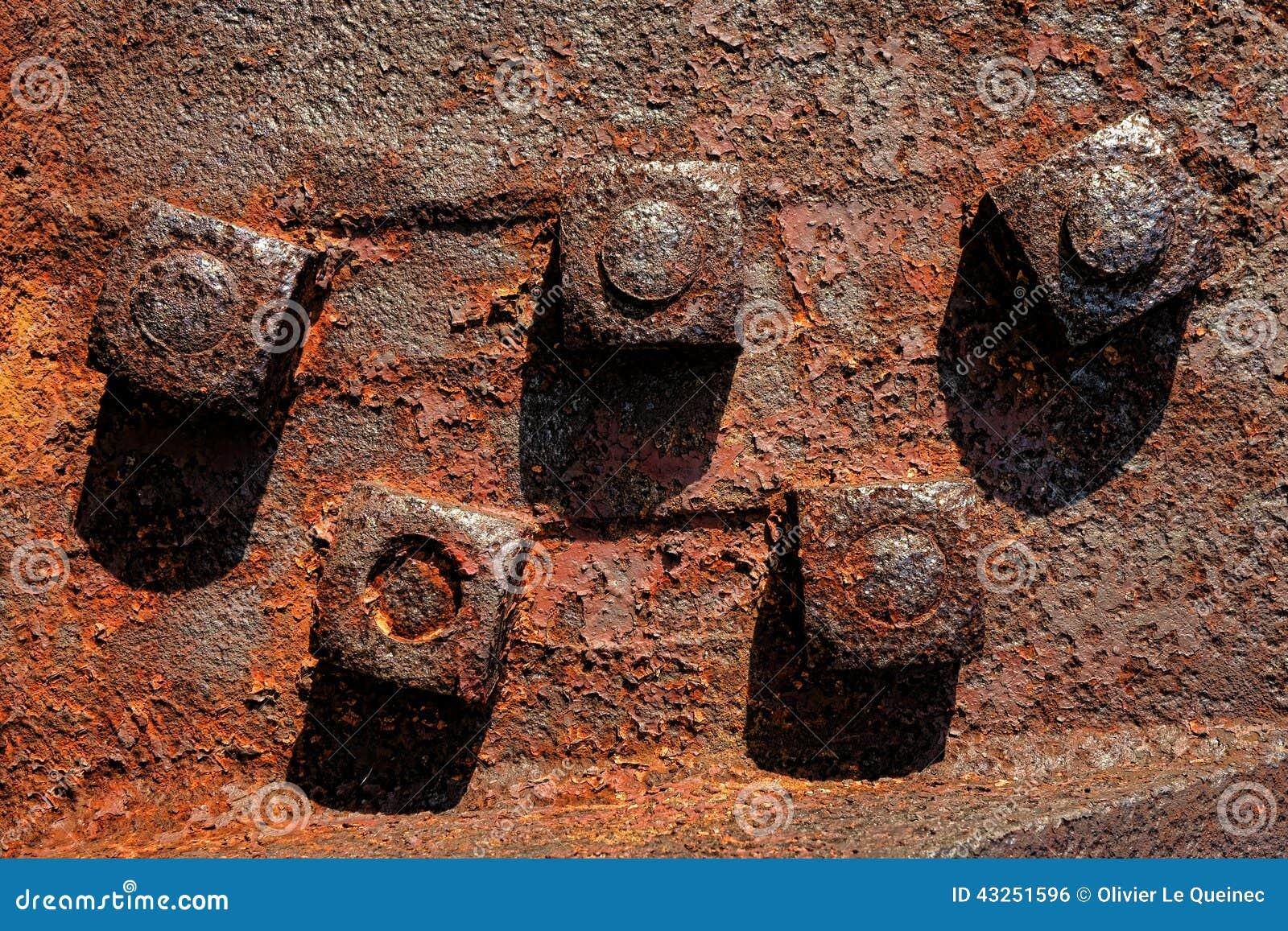 Rusty Nuts antigo nos parafusos industriais do metal da oxidação