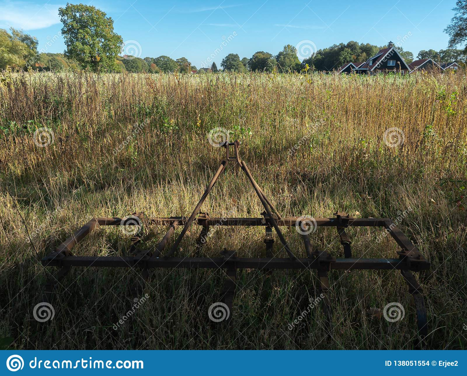 Rusty, old farm equipment. His last resting place.