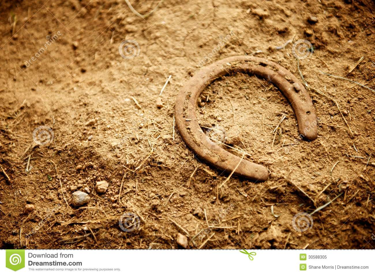 Rusty Old Horse Shoe Lying In Dirt Royalty Free Stock