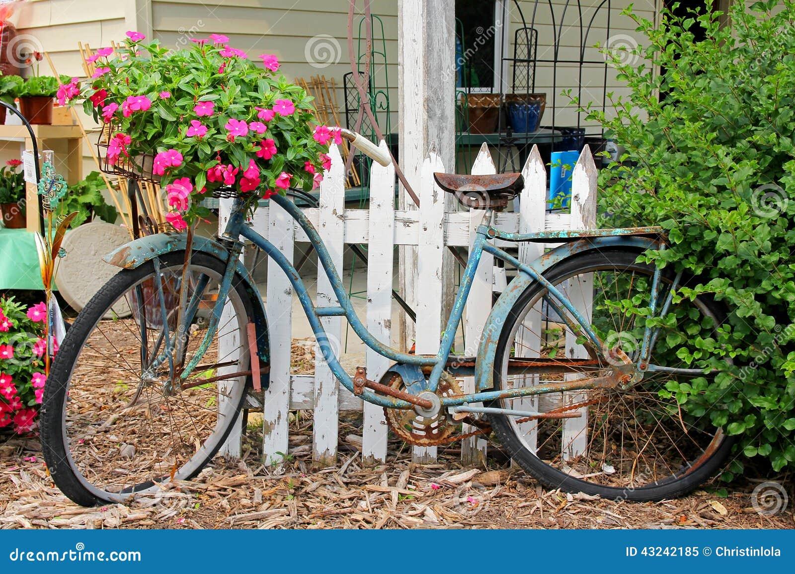 Rusty Old Vintage Bike Displayed In Flower Garden Stock