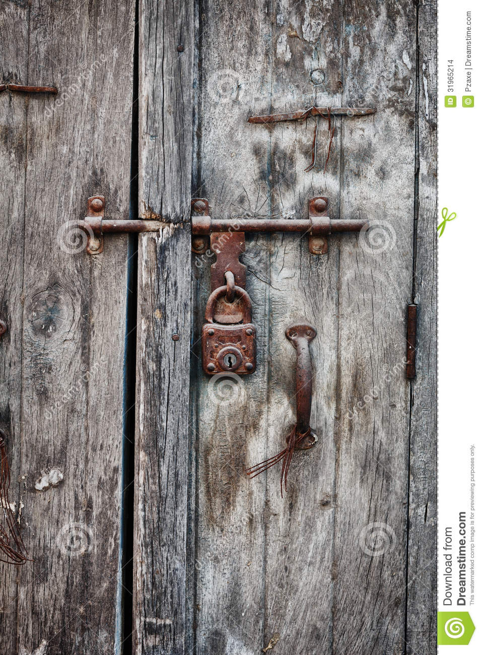 Rusty Padlock On An Old Wooden Door Of The House Stock