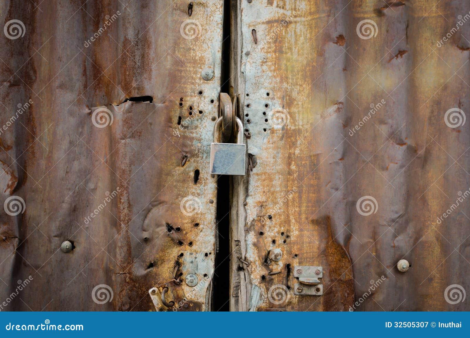Rusty Zinc Door Lock With Key Royalty Free Stock