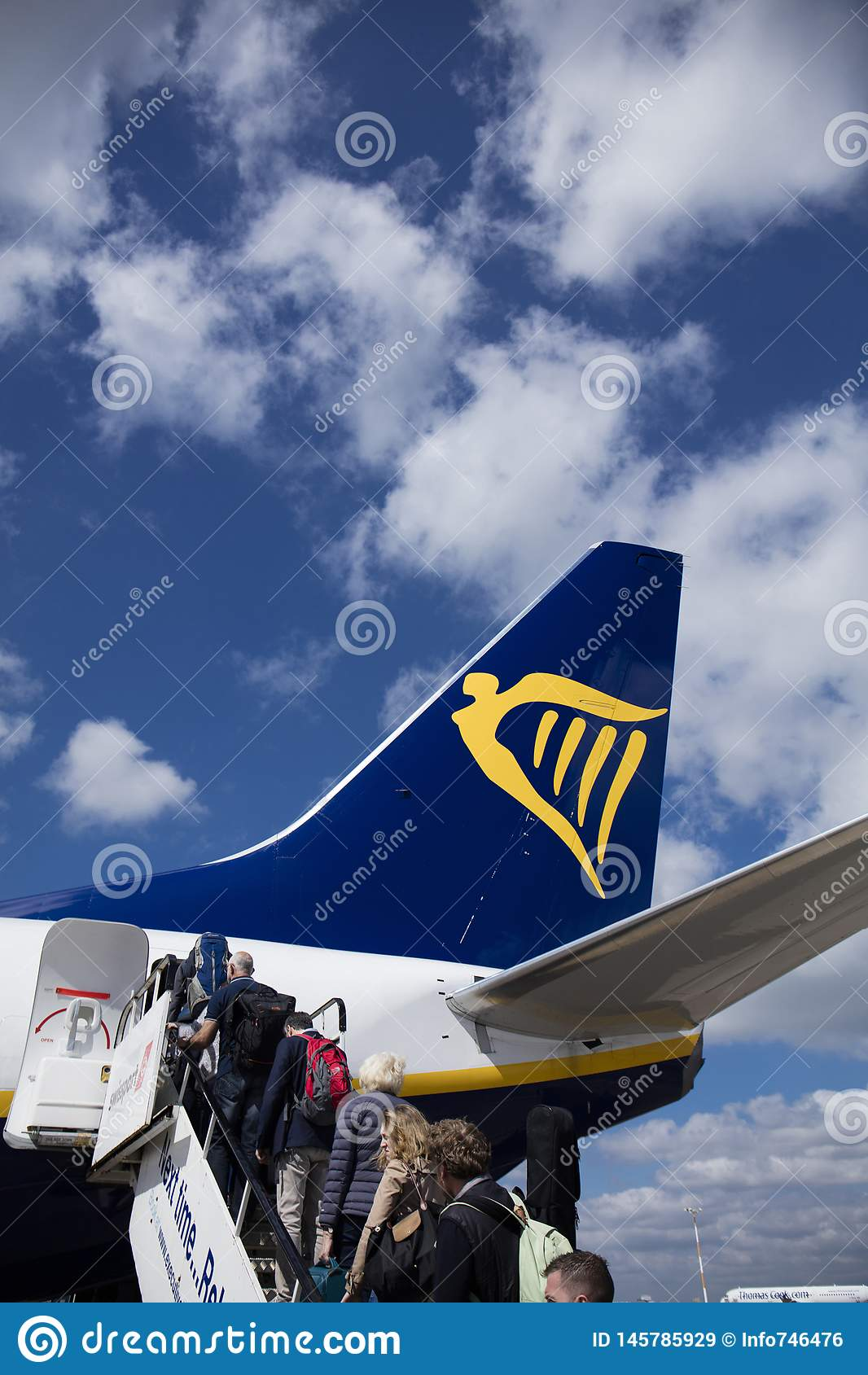 Ryanair Boeing 737 with passengers boarding at rear doors - East Midlands Airport, Derbyshire, United Kingdom - 15th May 2016
