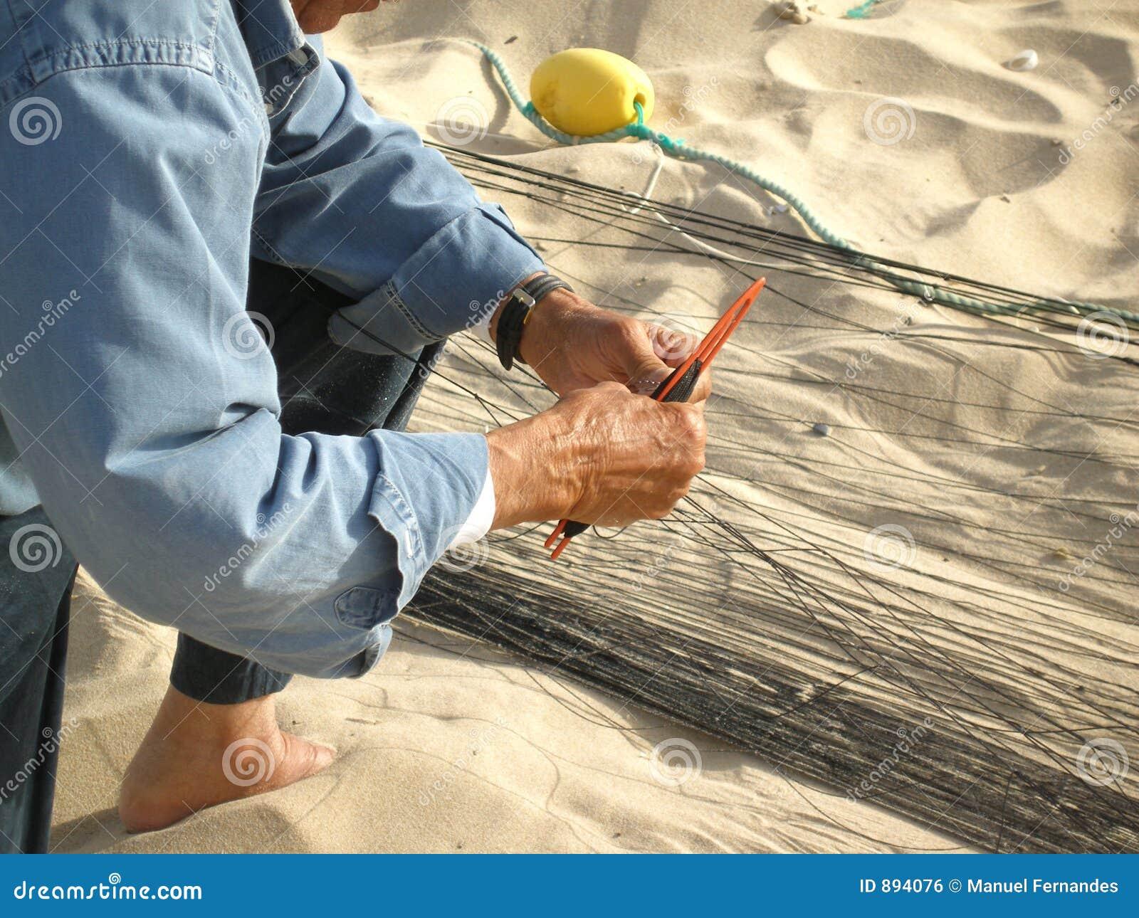 Rybacy zacerowania sieci rybackich