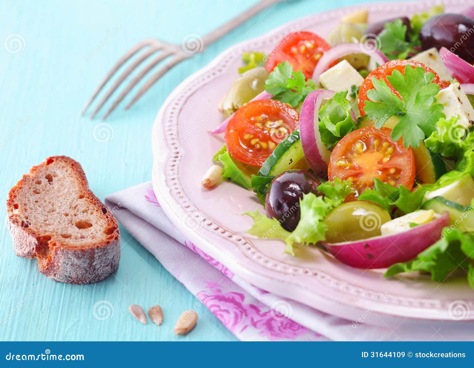 Rye bread and feta salad stock image. Image of greens ...