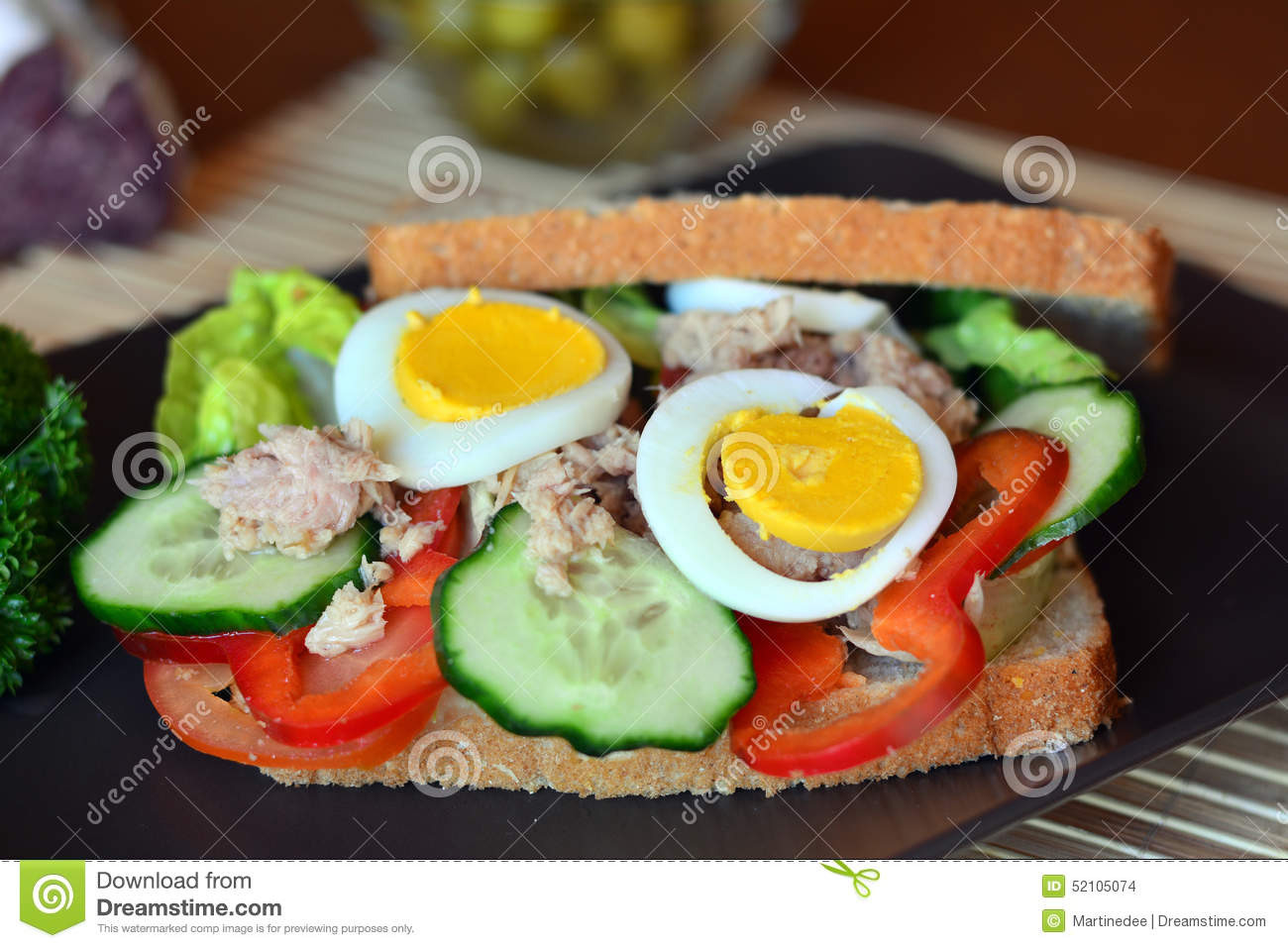 Rye bread sandwich with tuna fish eggs tomato and for How to make tuna fish with eggs