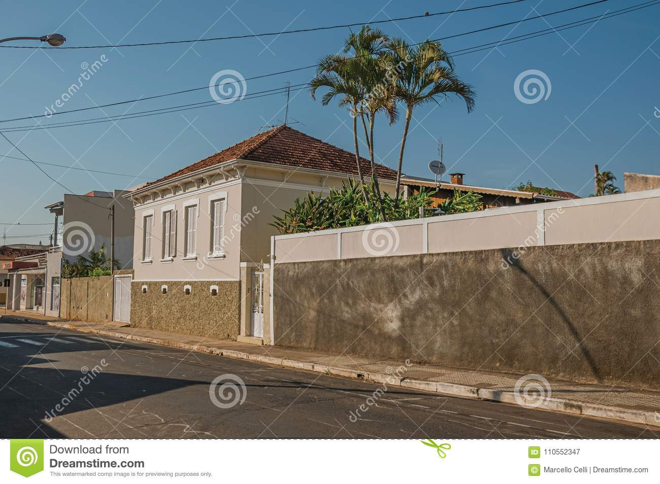working class old house with wall in an empty street on a sunny day rh dreamstime com house with one wall house with wall