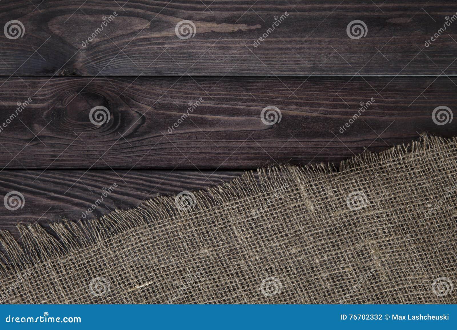 Säckvävtextur på träbakgrund