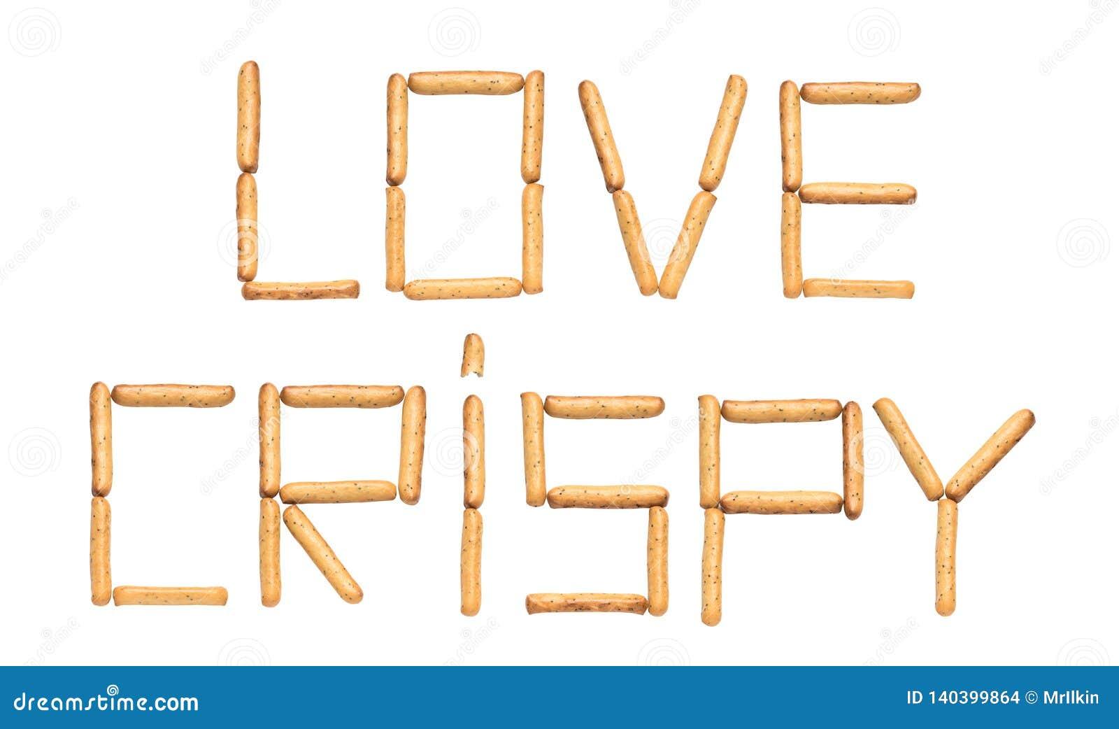 Słowo miłości Crispy opanowany chlebowymi kijami z makowymi ziarnami na białym tle