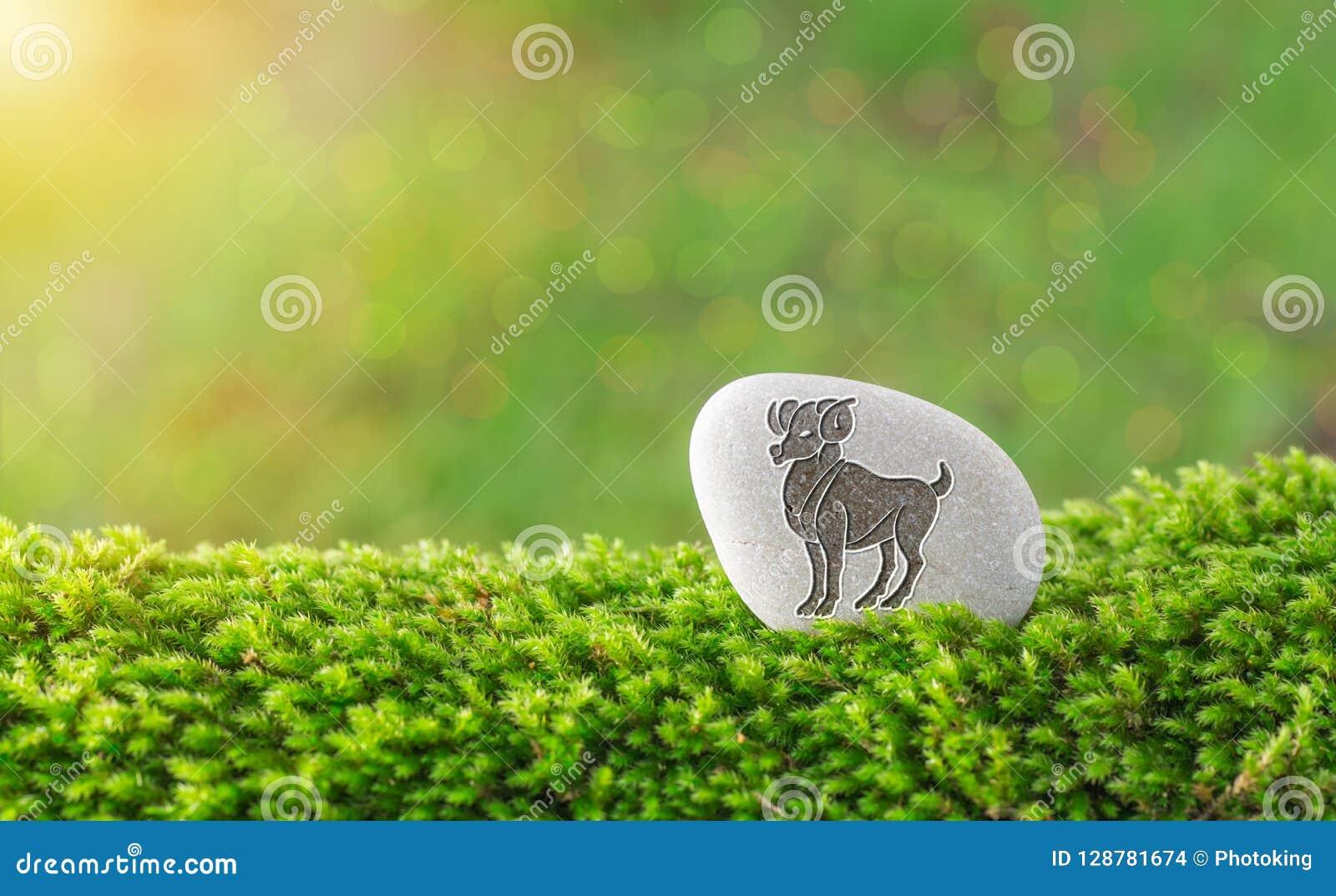 Símbolo del zodiaco del aries en piedra
