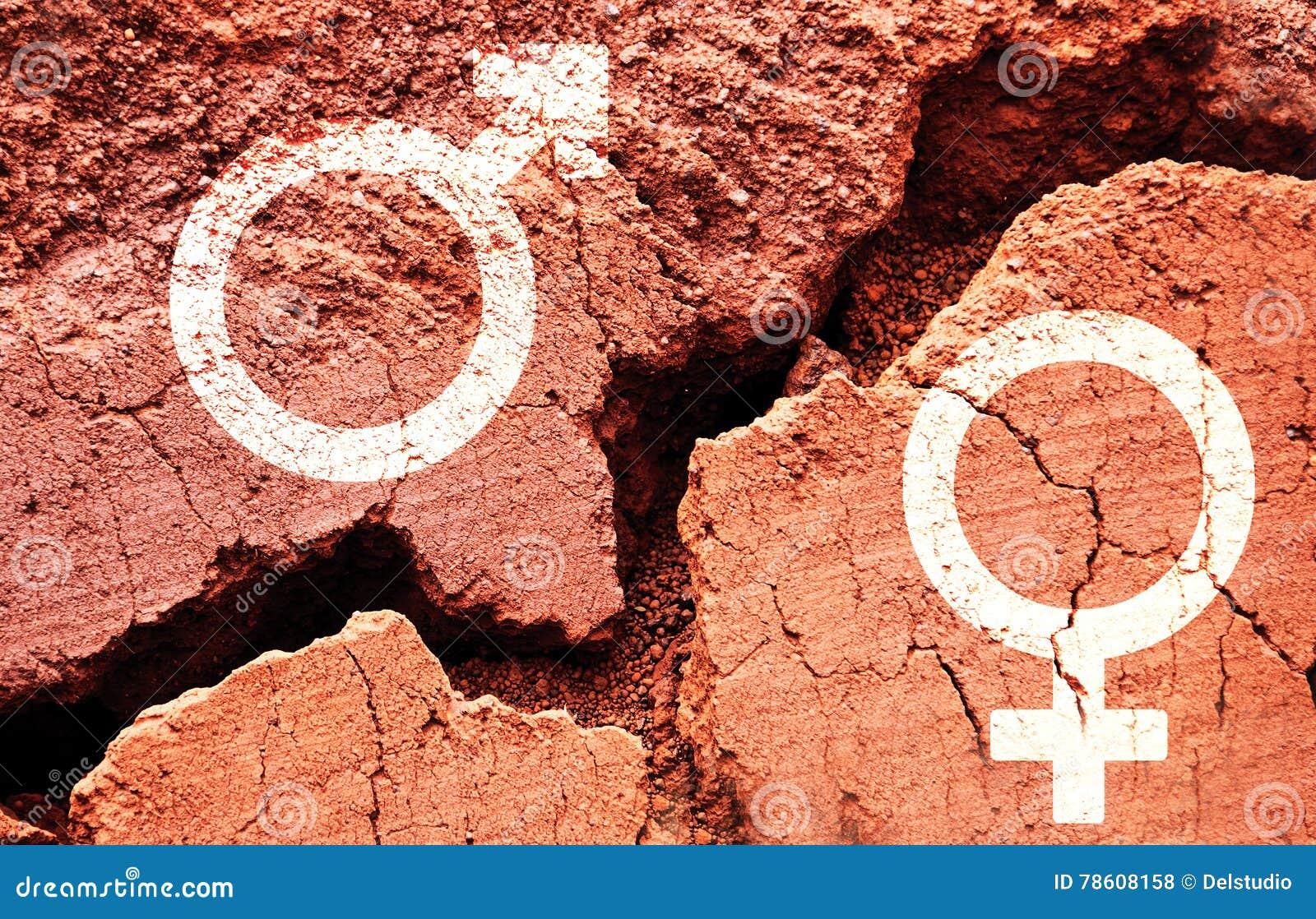 Símbolos del género en fondo de la tierra con una grieta grande