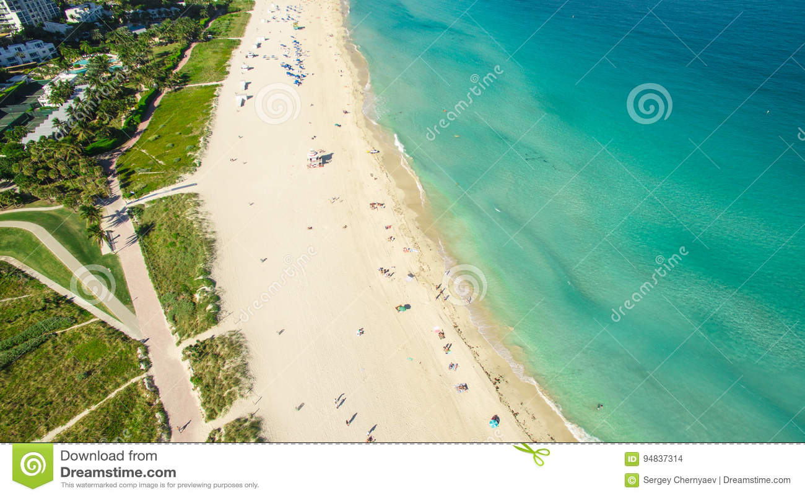 Südstrand, Miami Beach florida Schattenbild des kauernden Geschäftsmannes