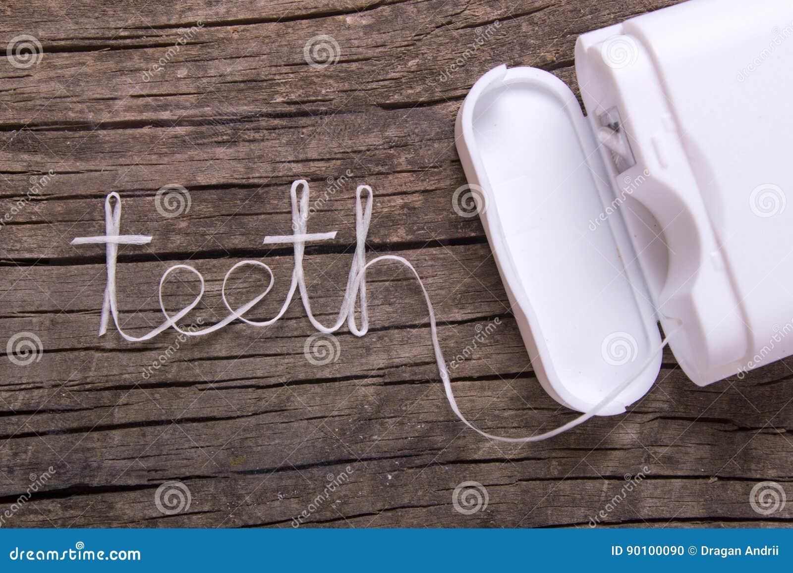 Słowo zęby stomatologiczny floss