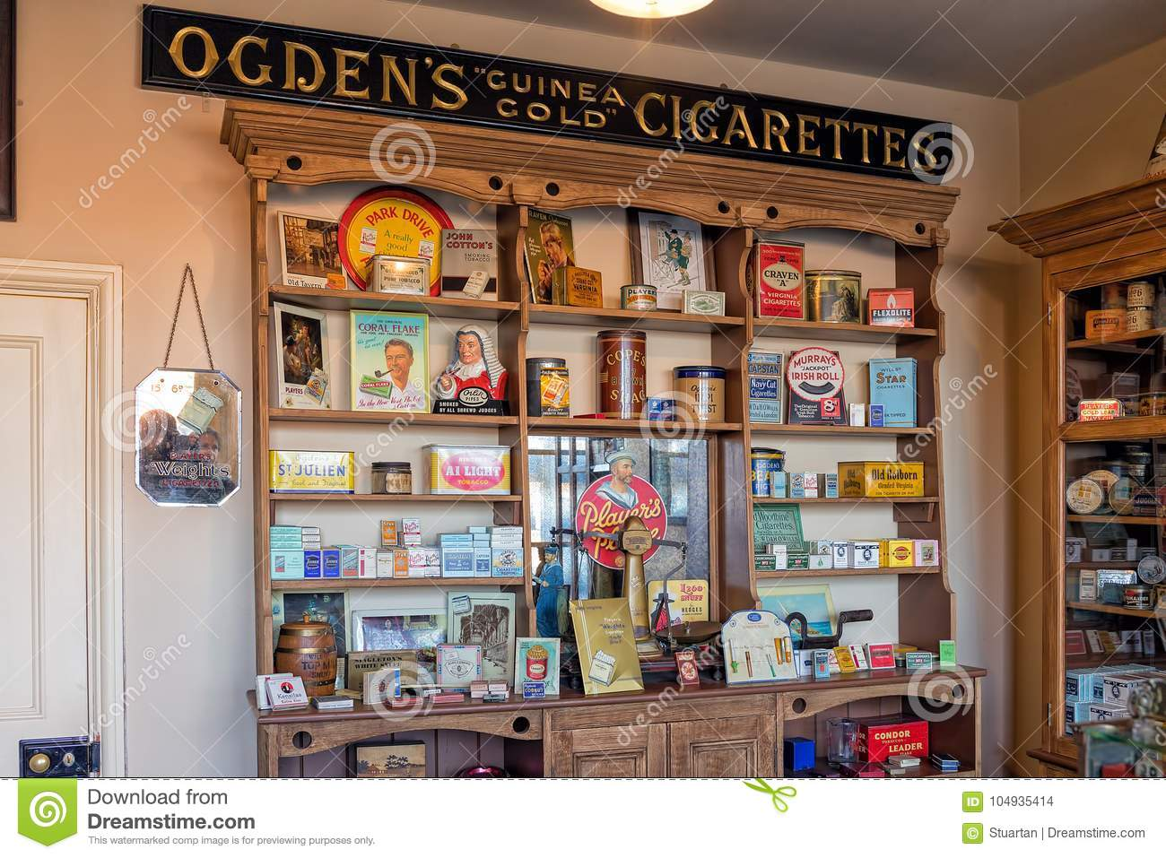 A Cabinet Displaying A Variety Of Well Known Cigarette And Tobacco Brands  Together With Smoking Accessories From The Early To Mid 20th Century.