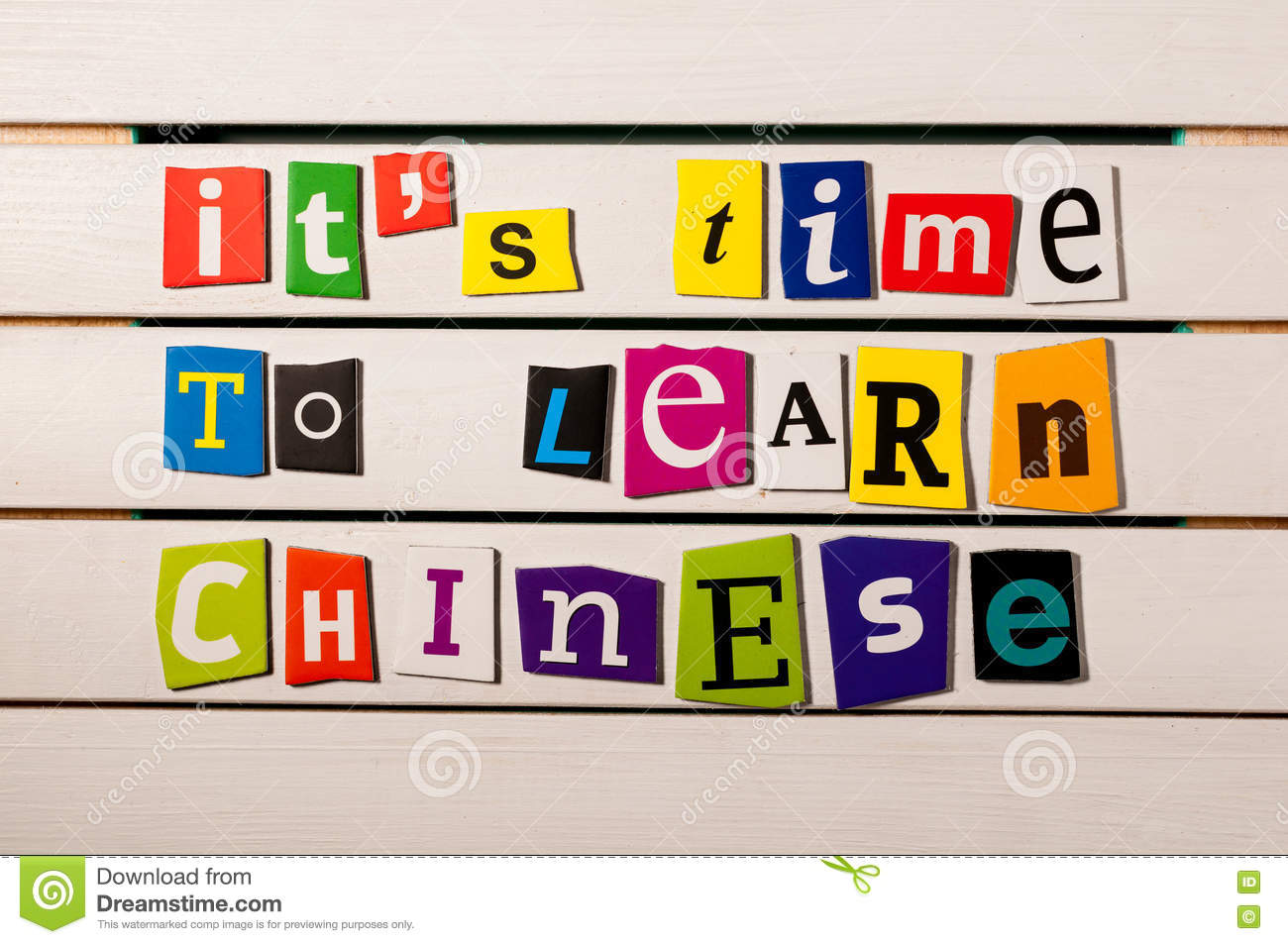It s time to learn chinese - written with color magazine letter clippings on wooden board. Chinese language learning
