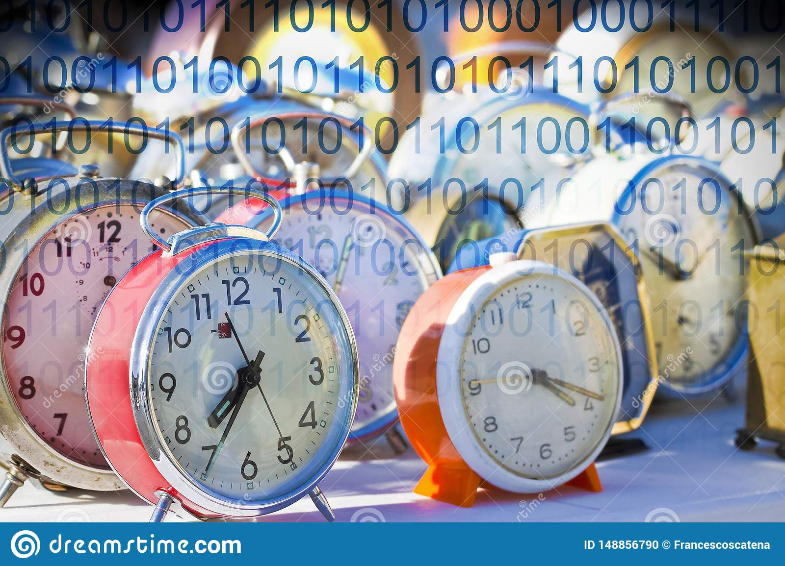 It`s time to protect your data - Concept image with old colored metal table clocks with binary code