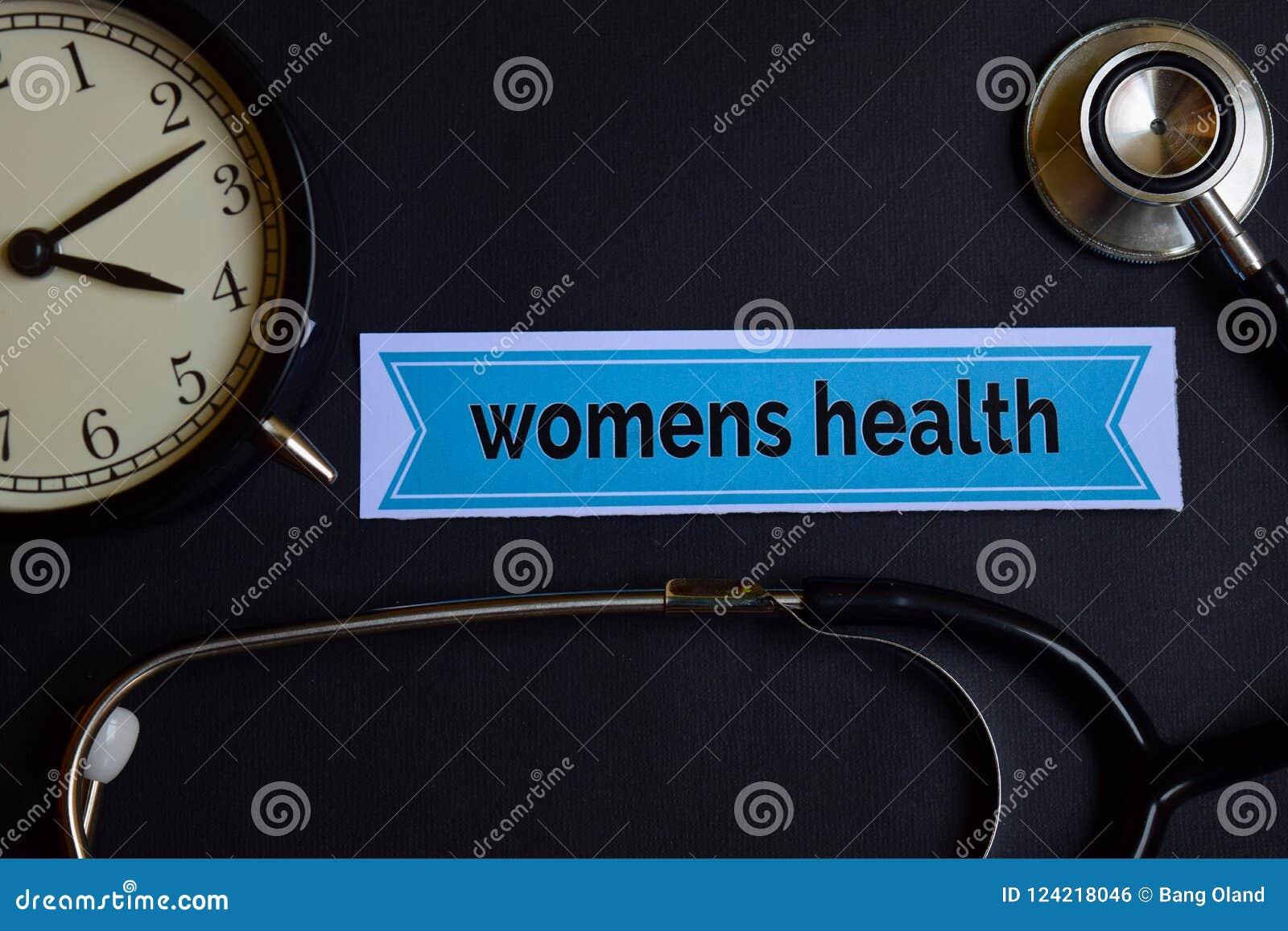 A saúde das mulheres no papel da cópia com inspiração do conceito dos cuidados médicos despertador, estetoscópio preto