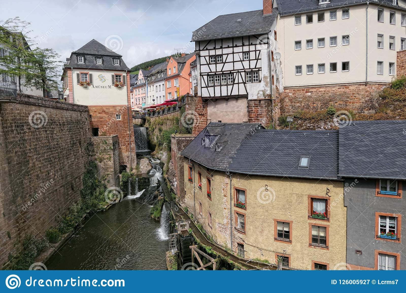 Cityscape of Saarburg with its historical old town part and Leuk River flowing into the city towards the ancient mills.