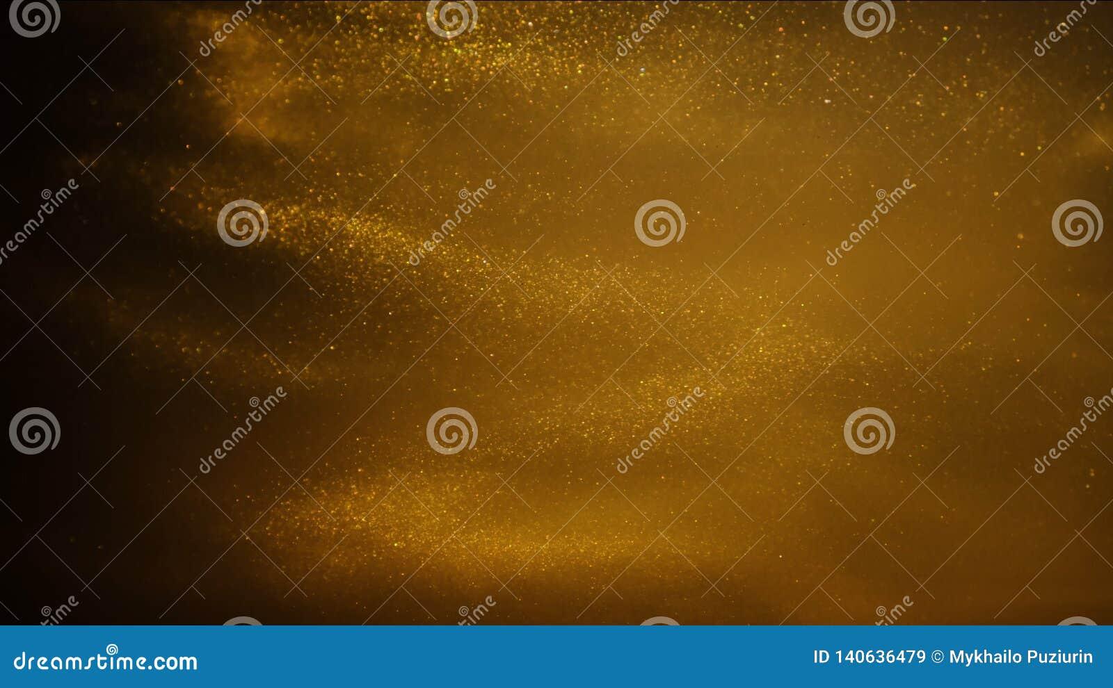 Sable ou poussière d or créant des formations abstraites de nuage Milieux d art