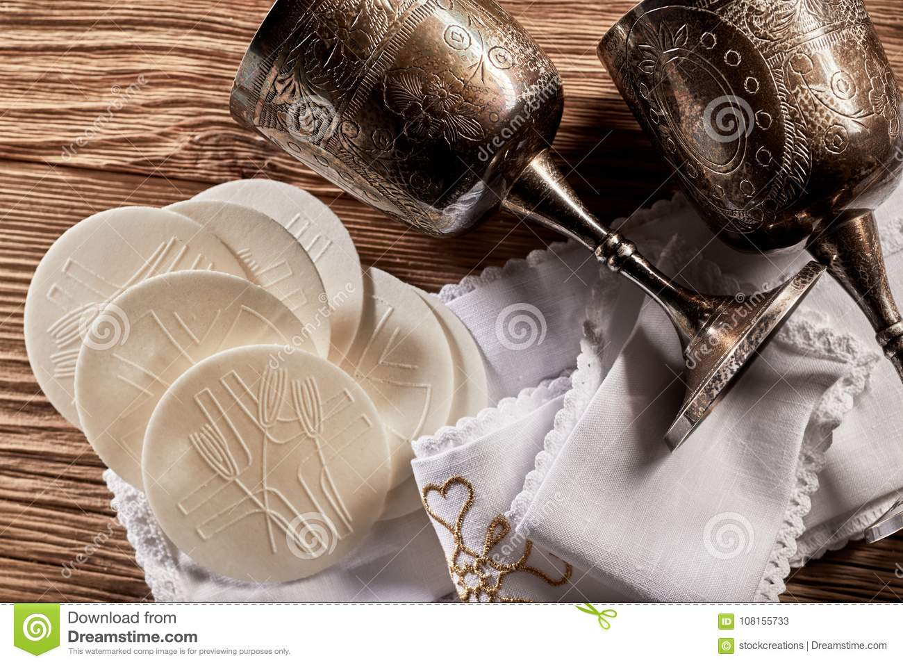 Sacramental Hosties with silver chalice cups