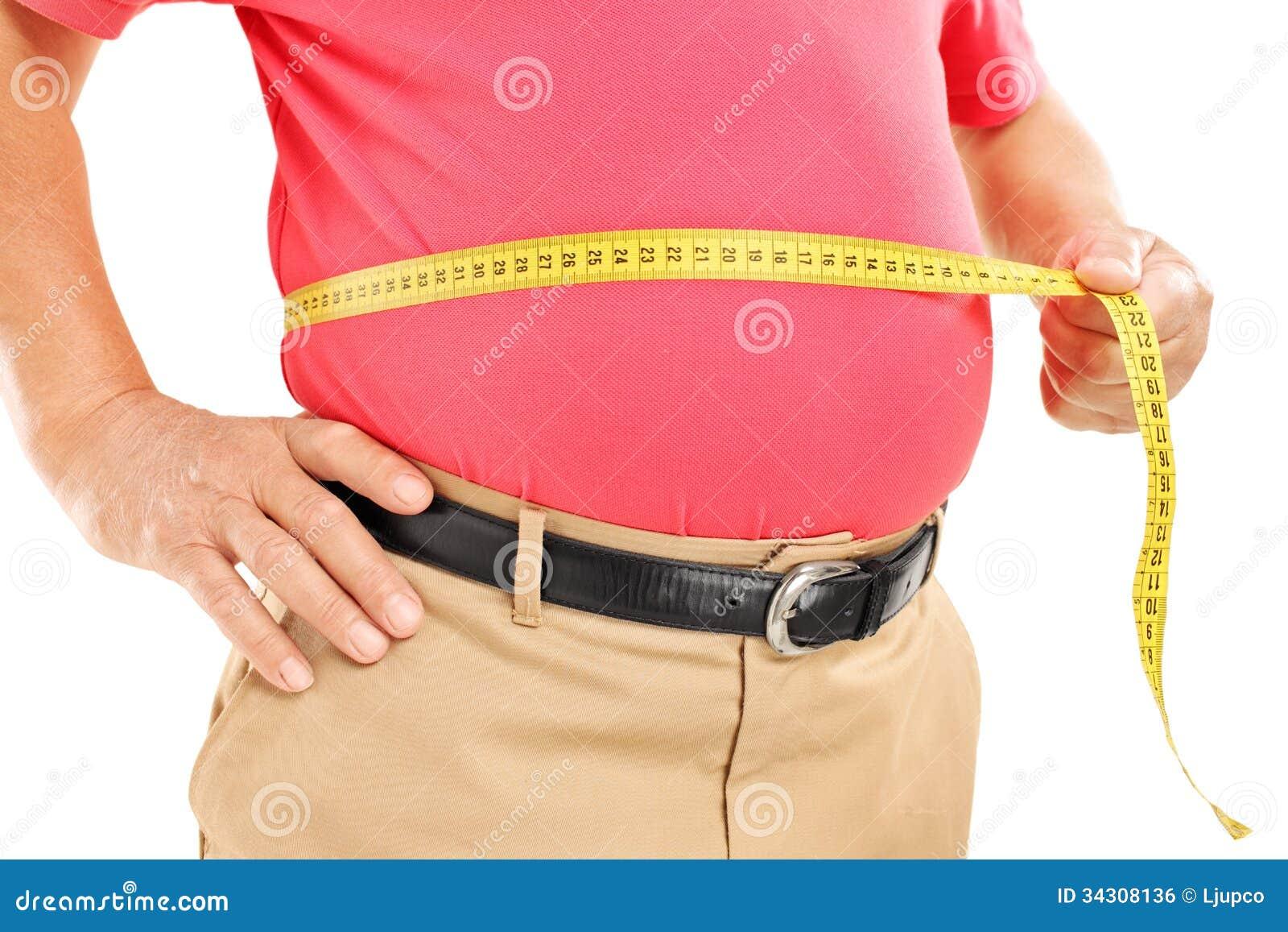 Sadło dojrzały mężczyzna mierzy jego brzucha z pomiar taśmą