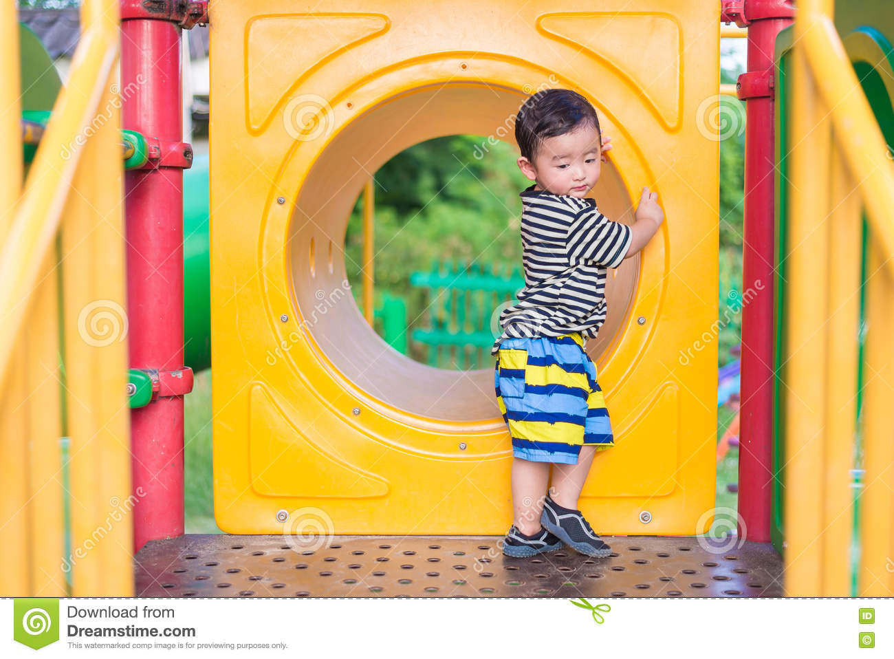 Sad Asian Boy Playing In Yellow Tunnel At The Playground With Sunlight In Summer Yellow Tube Shallow Dof