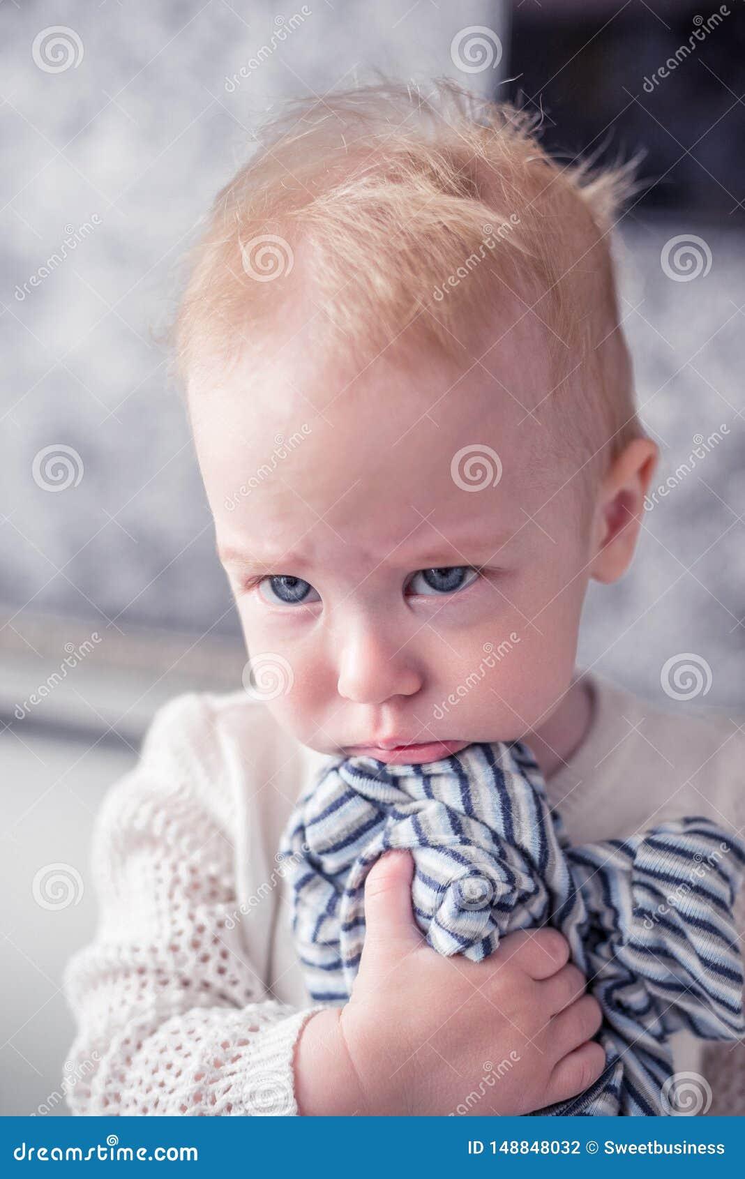 Sad Baby Girl Looking Aside Close Up Stock Photo - Image ...