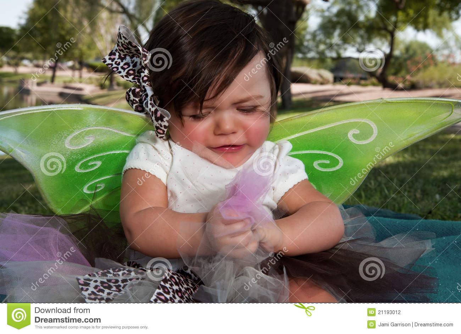 Sad Baby Girl wearing Wings
