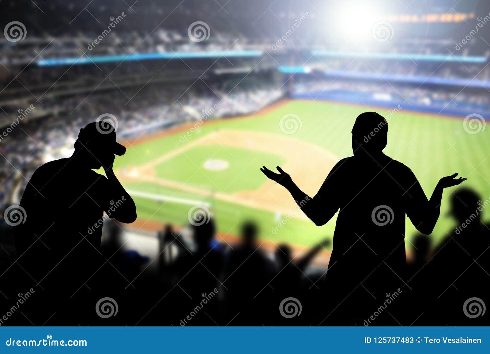 Sad baseball fans in stadium.