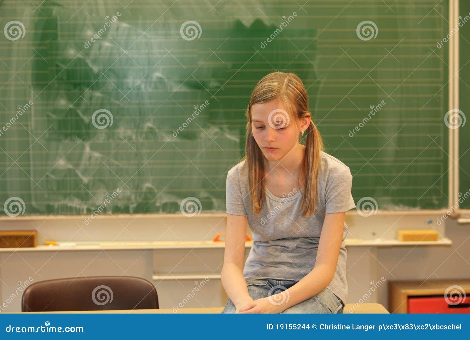 Sad blonde girl in school