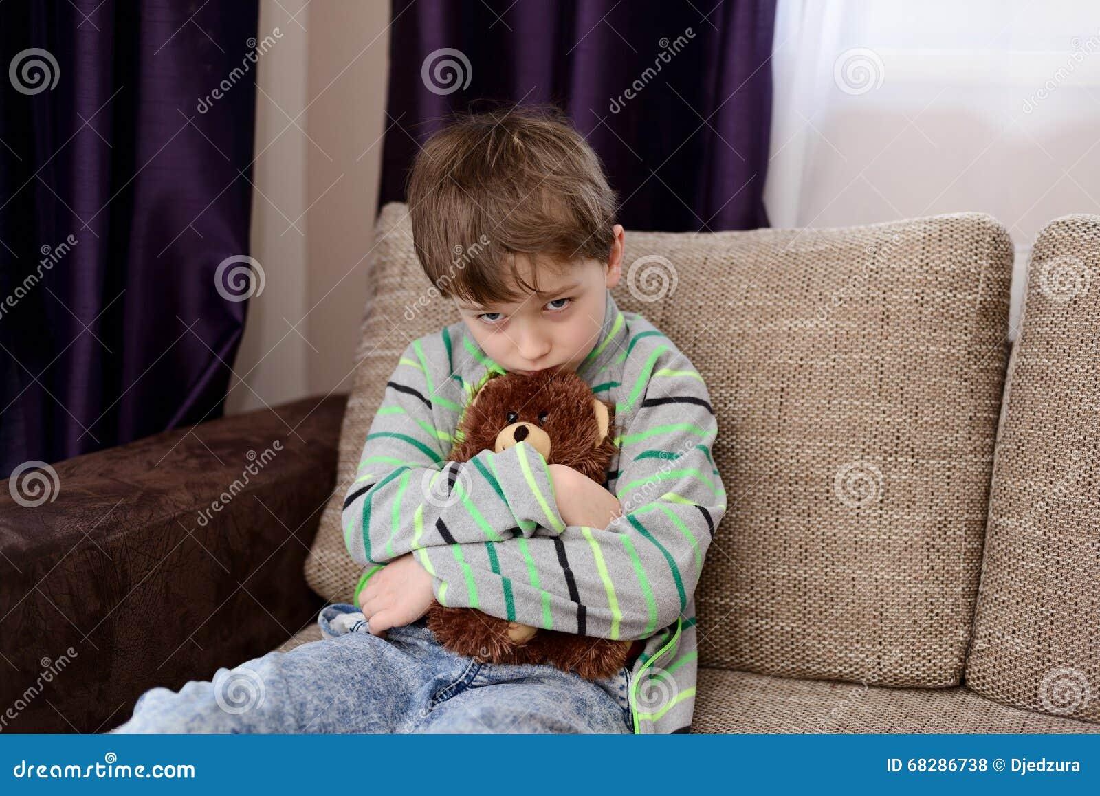 Sad Boy Hugs His Favorite Teddy Bear Stock Photo Image